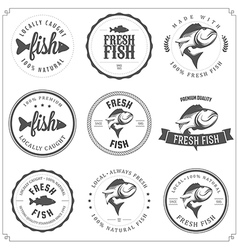 Set of made with fish stamps labels and badges vector image