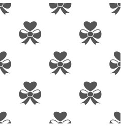 Seamless heart with bow pattern gift symbol from vector
