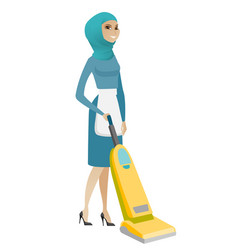 Muslim chambermaid cleaning floor with a vacuum vector