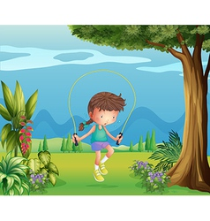 A girl playing jumping rope near the tree vector