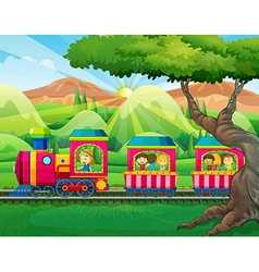Children riding on the train vector image