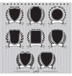 Shields laurel wreaths and ribbons vector