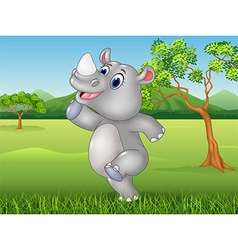 Cartoon funny rhino posing in the jungle vector