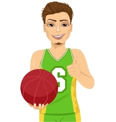 male basketball player holding ball vector image vector image