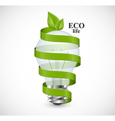 Eco energy concept light bulb wrapped with green vector