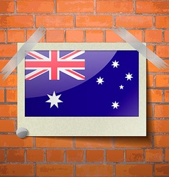 Flags australia scotch taped to a red brick wall vector