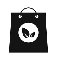 Paper bag with leaves black icon vector