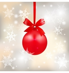 Red shiny ball with a bow on a beautiful Christmas vector image