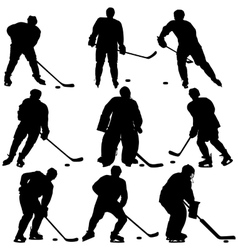 Set of silhouettes hockey player isolated on vector
