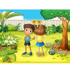 A boy and a girl arguing in the garden vector