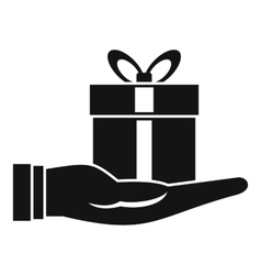 Gift box in hand icon simple style vector image