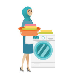 muslim housewife using washing machine at laundry vector image