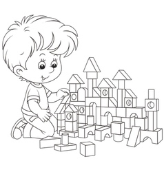 Boy playing with bricks vector