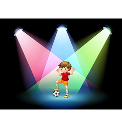 A soccer player at the stage with spotlights vector