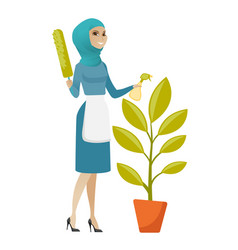 Young muslim housemaid watering flower with spray vector