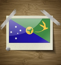 Flags christmas island at frame on wooden texture vector