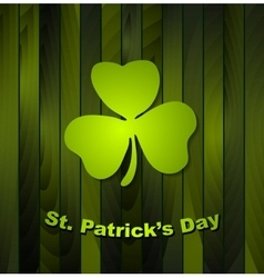 Clovers shamrock on green wooden background vector