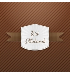 Eid mubarak paper emblem with ribbon vector