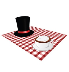 Cup of coffe with hat on tablecloth vector