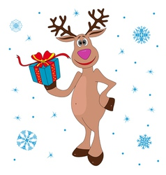Christmas Reindeer holding a gift vector image vector image