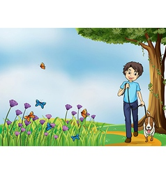 A young boy walking with his pet vector
