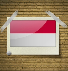 Flags indonesia at frame on a brick background vector