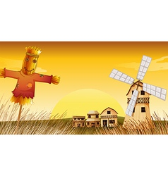 A farm with a scarecrow and a windmill vector