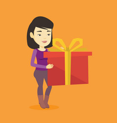 joyful asian woman holding box with gift vector image vector image