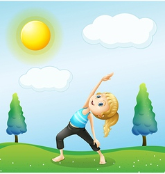 A girl exercising above the hills vector