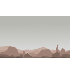 Silhouette of many rock in hills scenery vector