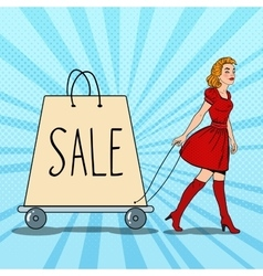 Pop art woman with giant shopping bag on sale vector
