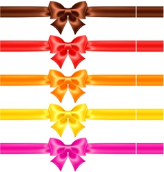 Silk bows in warm colors with ribbons vector