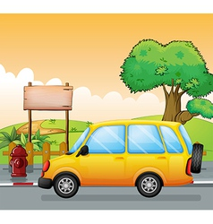 A yellow car and an empty signage vector image