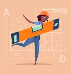 Cartoon woman builder holding carpenter level vector