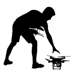 Black silhouette of a man operates unmanned vector image vector image
