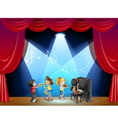 Children playing musical instrument on stage vector image