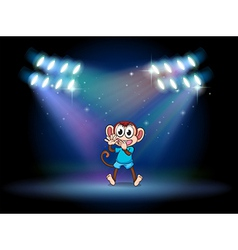 A monkey dancing at the stage with spotlights vector image