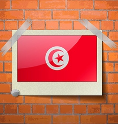 Flags tunisia scotch taped to a red brick wall vector