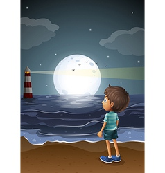 A young boy watching a fullmoon at the beach vector image