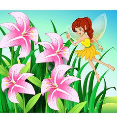 A fairy pointing the pink flowers at the garden vector