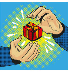 gift box in hand with golden bow and ribbons pop vector image vector image