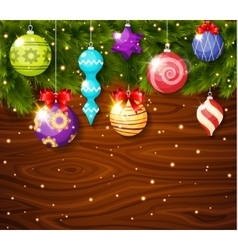 Christmas baubles on wood board vector