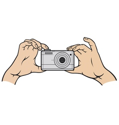 Camera in hands vector image vector image