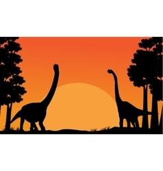 Silhouette of dinosaur brachiosaurus with orange vector