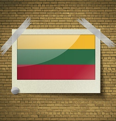 Flags lithuania at frame on a brick background vector