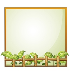 An empty frame with a wooden fence and vine plants vector image