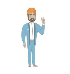 Hindu businessman showing victory gesture vector