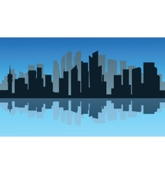 Silhouette of city and reflection at night vector