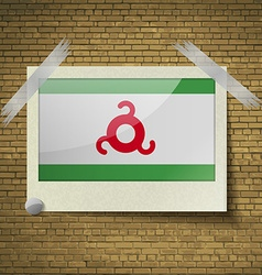Flags ingushetia at frame on a brick background vector