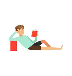 Young man sitting on the floor and reading a book vector